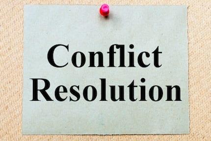 Conflict Resolution Through High-Level Negotiation